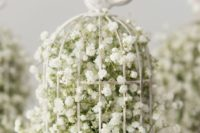 a birdcage wedding centerpiece