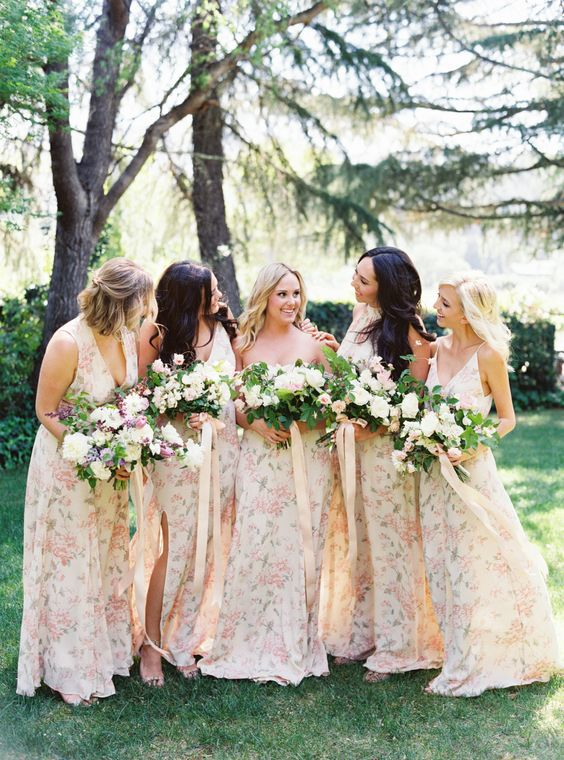 subtle mismatched watercolor floral print bridesmaids' dresses with various cuts and necklines for a spring wedding