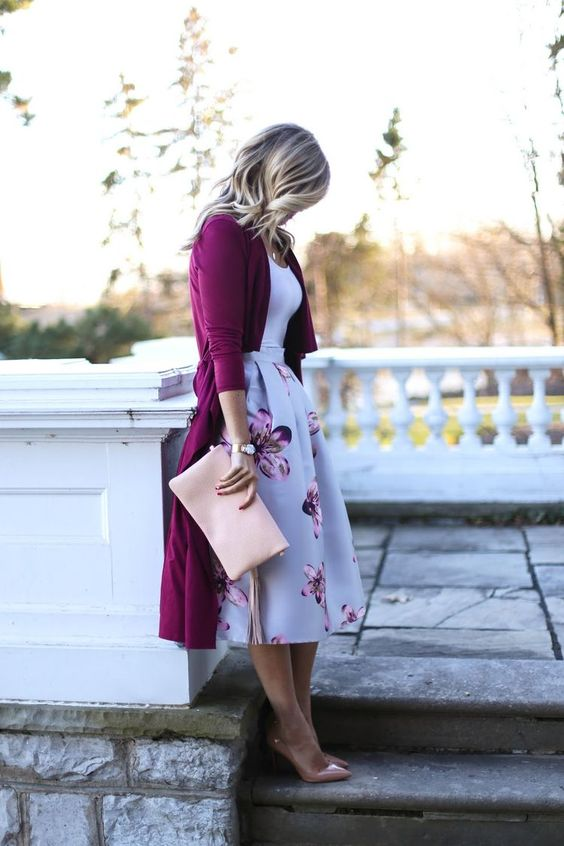 a floral A-line midi skirt, a white top, a plum-colored cardigan, blush shoes and a matching clutch
