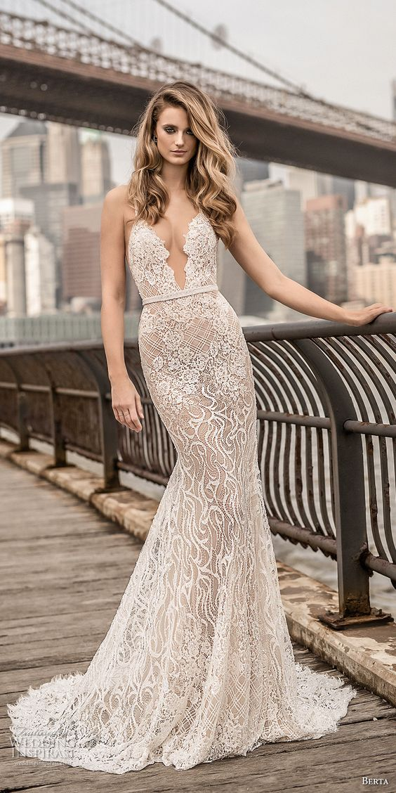 Picture Of a mermaid spaghetti strap wedding dress with a plunging  neckline, embellishments and an open back by Berta Bridals