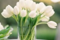 08 a modern glass vase with white tulips is an ideal and simple wedding centerpiece