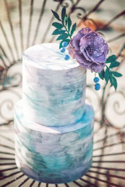 Picture Of A Watercolor Wedding Cake In The Shades Lilac And Turquoise With Large Purple Fl Blue Berries On Top