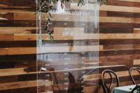 08 an acrylic seating chart with fresh greenery garlands for cute decor
