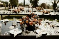 08 the table settings were done with lush florals, bare tables and some fruit – persimmons and peaches for a southern feel