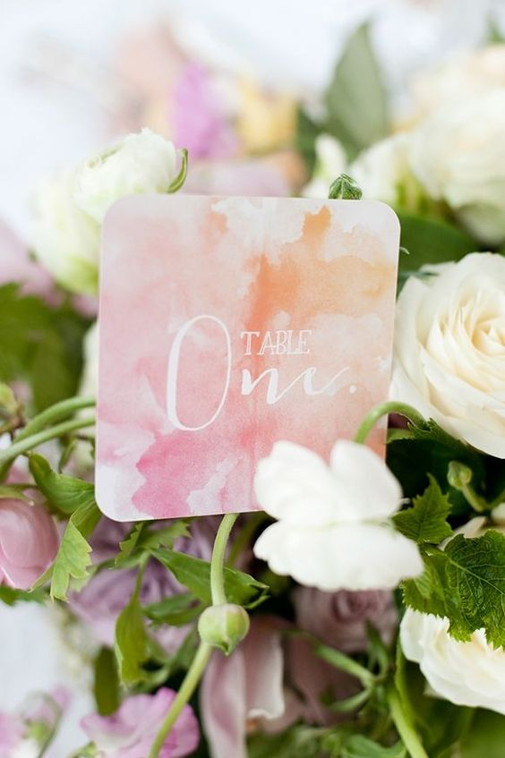 watercolor orange and pink wedding table number in the blooms