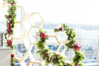 08 wooden hexagon backdrop with greenery and fuchsia florals for a bold modern wedding