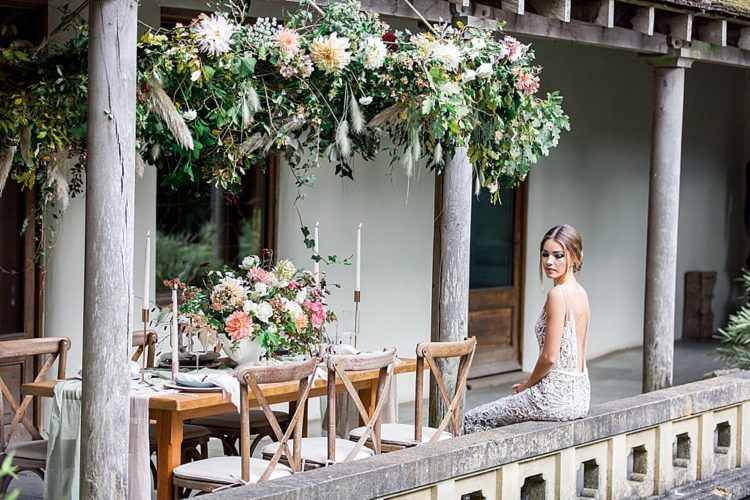 Lush boho floral decorations were created for the shoot including this one hanging over the table
