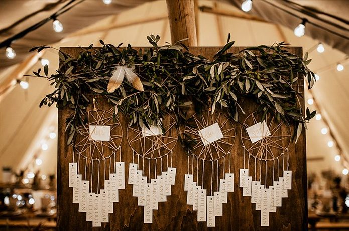 The seating chart was done with dream catchers and lush greenery