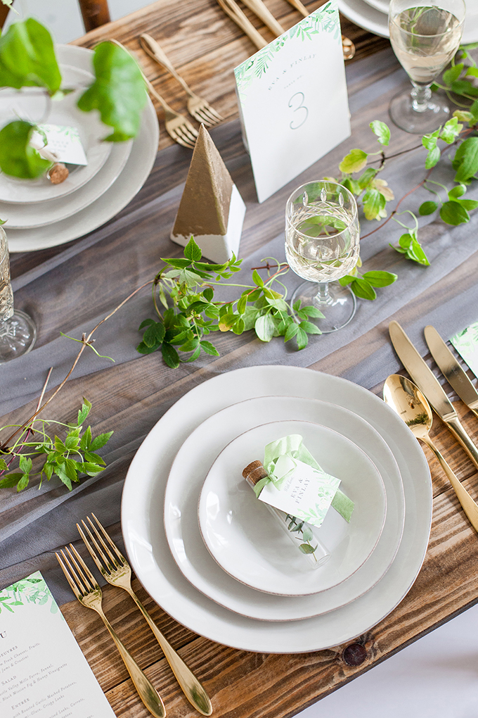 The tablescape was done with an ethereal table runner, fresh greenery and some gilded touches for elegance