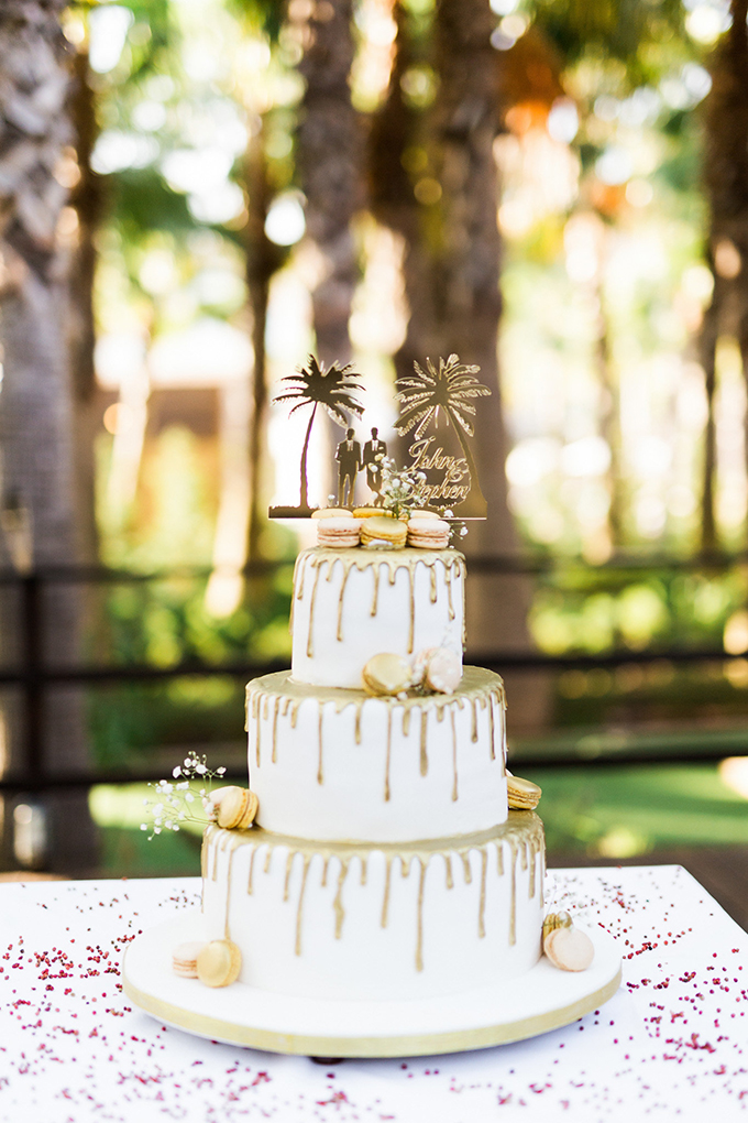 The wedding cake was a white one with gold dripping and macarons and an eye-catchy topper