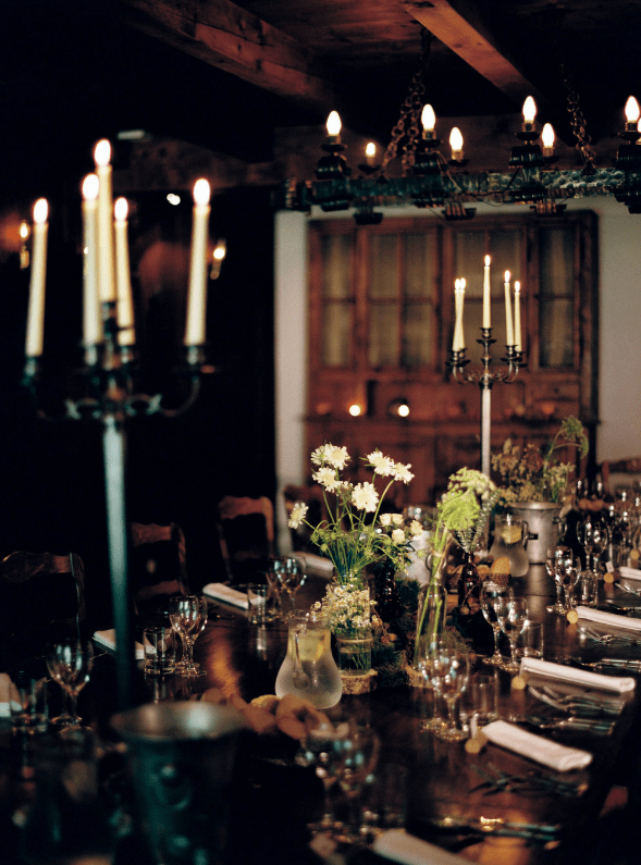 The wedding reception took place in the farmhouse, which was candlelit and decorated very simply, with rustic touches