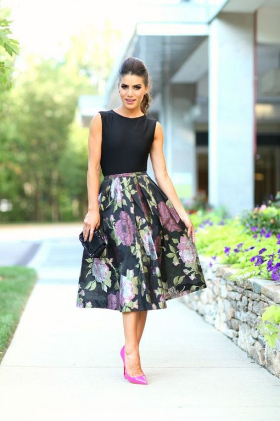 a black sleeveless top and a floral midi A line skirt plus hot pink heels is a timeless and elegant look
