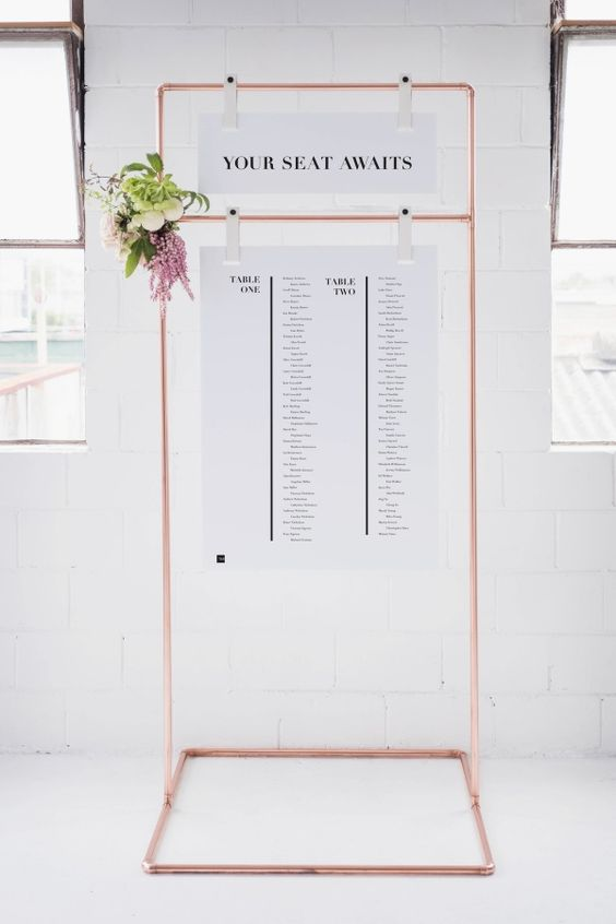 Picture Of A Copper Frame With Black And White Seating Charts And Fresh  Blooms