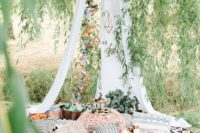 09 a gorgeous boho elopement picnic with a teepee, printed textiles and fresh greenery
