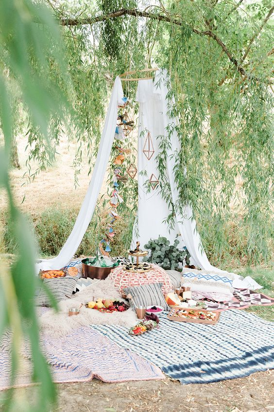 a gorgeous boho elopement picnic with a teepee, printed textiles and fresh greenery