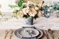 09 a moody spring wedding centerpiece with neutral blooms and some greenery