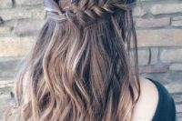 09 a wavy half updo with a thick fishtail braid on one side and twisted hair on the second
