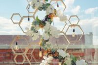 09 a wooden honeycomb wedding backdrop with bulbs, lush blooms and greenery for a trendy geo touch