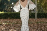 10 a chic mermaid wedding dress with bell sleeves, an open back and embroidery plus a bateau neckline