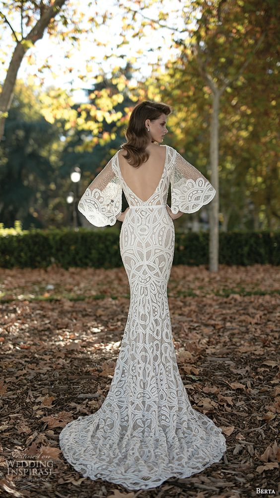 a chic mermaid wedding dress with bell sleeves, an open back and embroidery plus a bateau neckline