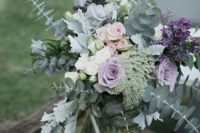 10 a pale wedding centerpiece with lilac and blush roses, eucalyptus, pale miller and lilac