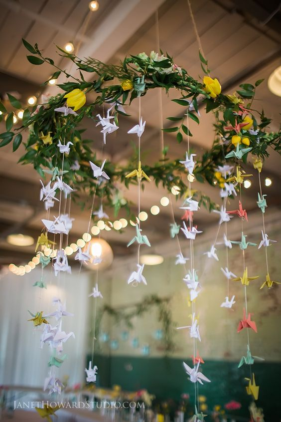 a pretty greenery and bloom chandeleir with pastel paper cranes for decorating the venue