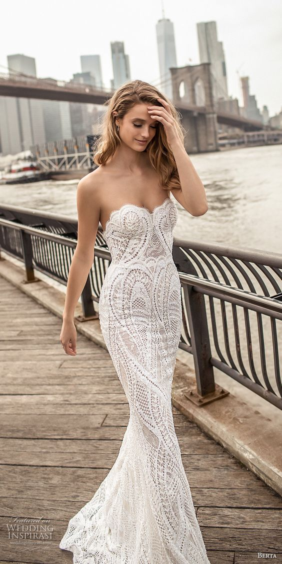 a sexy strapless sheath wedding gown of lace with a scallop edge for a cool look by Berta