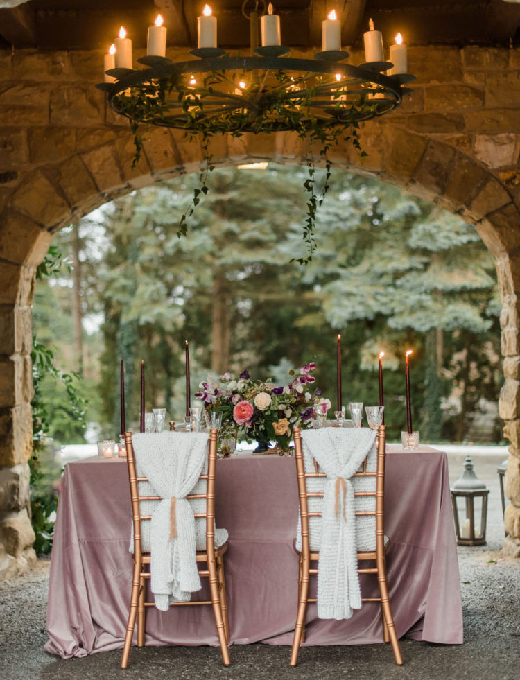 The dreamy reception was lit up with a chandelier and looked truly romantic