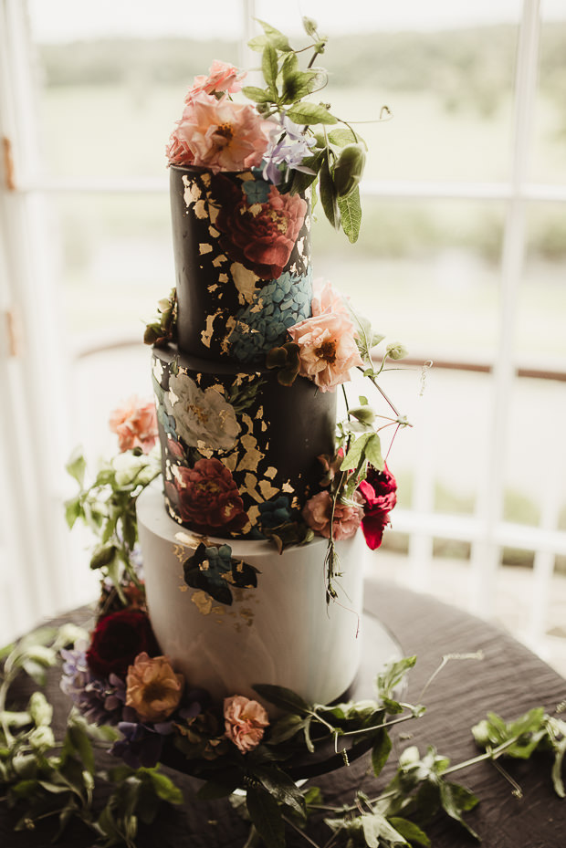 The wedding cake was a black and white one, with gold lead and hand painted flowers