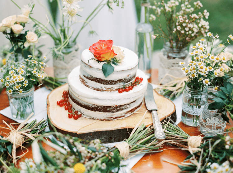 The wedding cake was a naked chocolate one topped with fresh berries and blooms