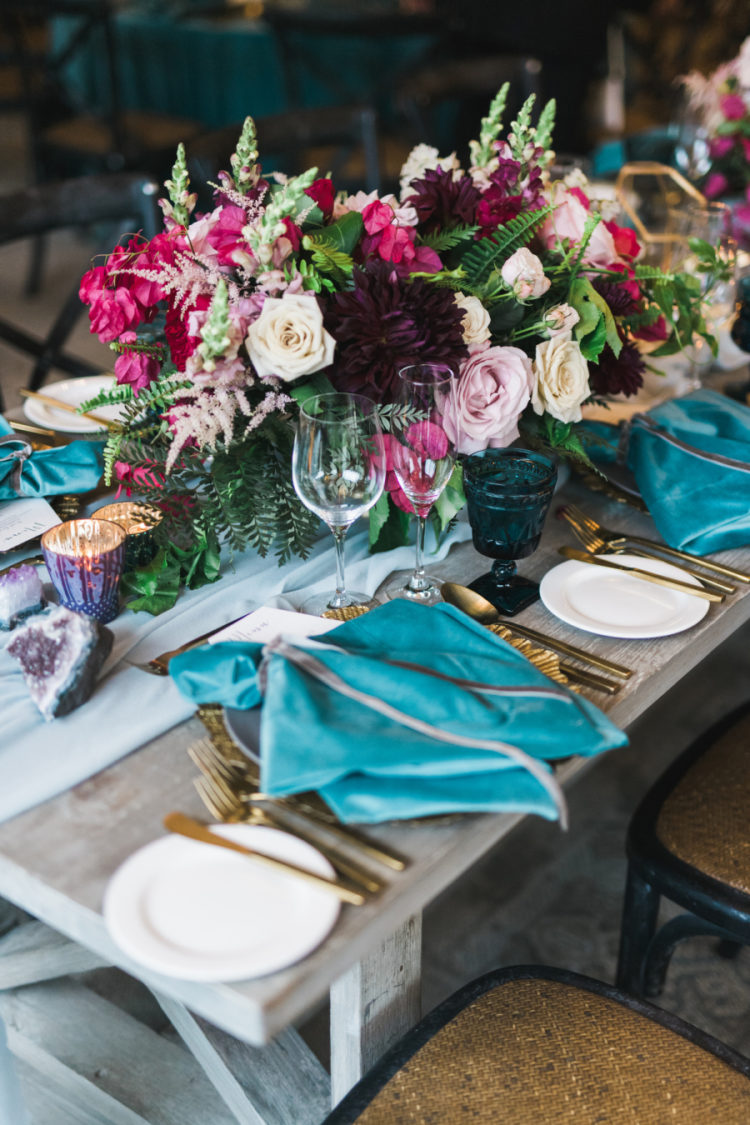 The wedding tablescape was done with blue and grey shades, very lush florals and geodes