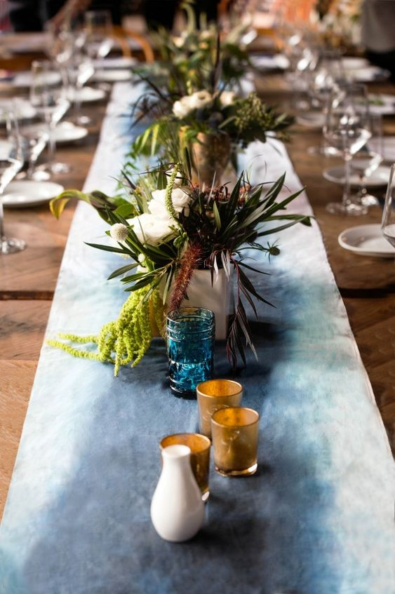 a dark blue watercolor wedding table runner for a boho chic wedding
