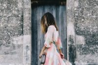 11 a pastel floral maxi dress with long sleeves and a grey clutch are ideal for spring