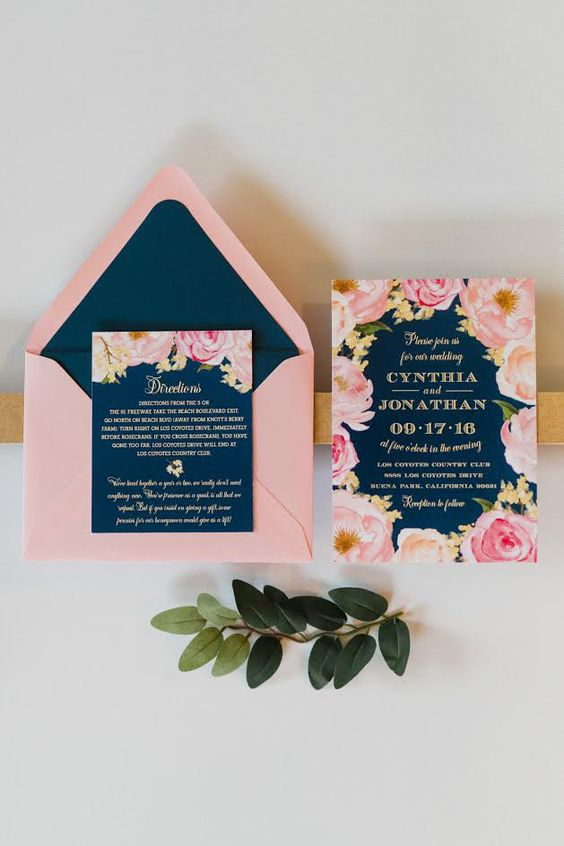a pink and navy floral wedding invitation for a bold summer wedding