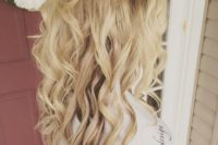 11 half up half down hairstyle with waves and a small braid going as a halo