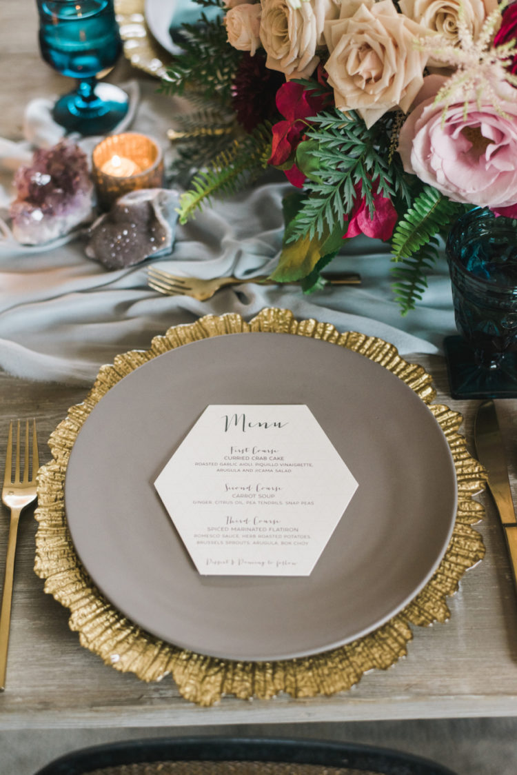 The chargers contrasted matte grey plates and geometric menus