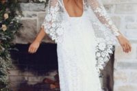 12 a boho lace wedding dress with a low back and wide bell sleeves