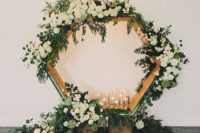 12 a large hexagon wooden arch with candles, lush white blooms and greenery all over