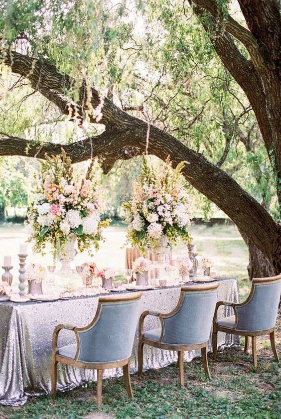 a pastel table setting in the shades of blush and powder blue chairs