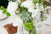 12 a sheer vase with white blooms, succulents and greenery