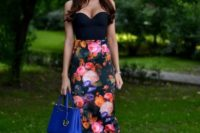 12 a strapless black top, a floral pencil skirt with a high waist, black strappy heels and a blue bag