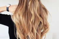 12 long wavy half updo with a fishtail braid and volume on top for a boho feel