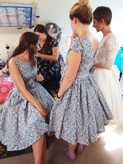 tea length blue and pink retro inspired bridesmaids' dresses with a bateau neckline and a full skirt