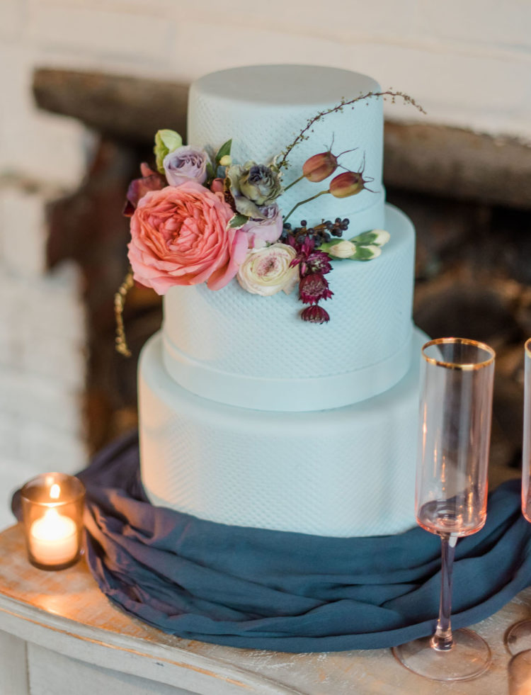 The wedding cake was a mint-colored one, with a texture and flowers on top