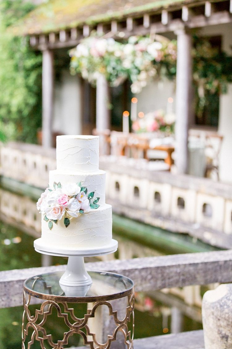 The wedding cake was a textural one, with lush blooms and greenery to fit the shoot theme