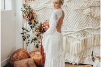 13 a boho lace wedding gown with a high neckline, a cutout back, bell sleeves
