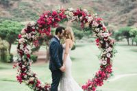 13 a bold fuchsia, blush and hot pink floral circle wedding arch with leaves