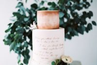 13 a wedding cake with copepr calligraphy and a peachy pink watercolor tier plus blooms for a romantic wedding