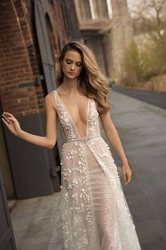 a wide strap plunging neckline sparkling wedding gown with lace appliques, an overskirt and an embellished sash by Berta