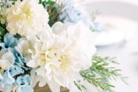 13 a wooden box with blue hydrngeas, white dahlias and textural greenery is ideal for a rustic wedding